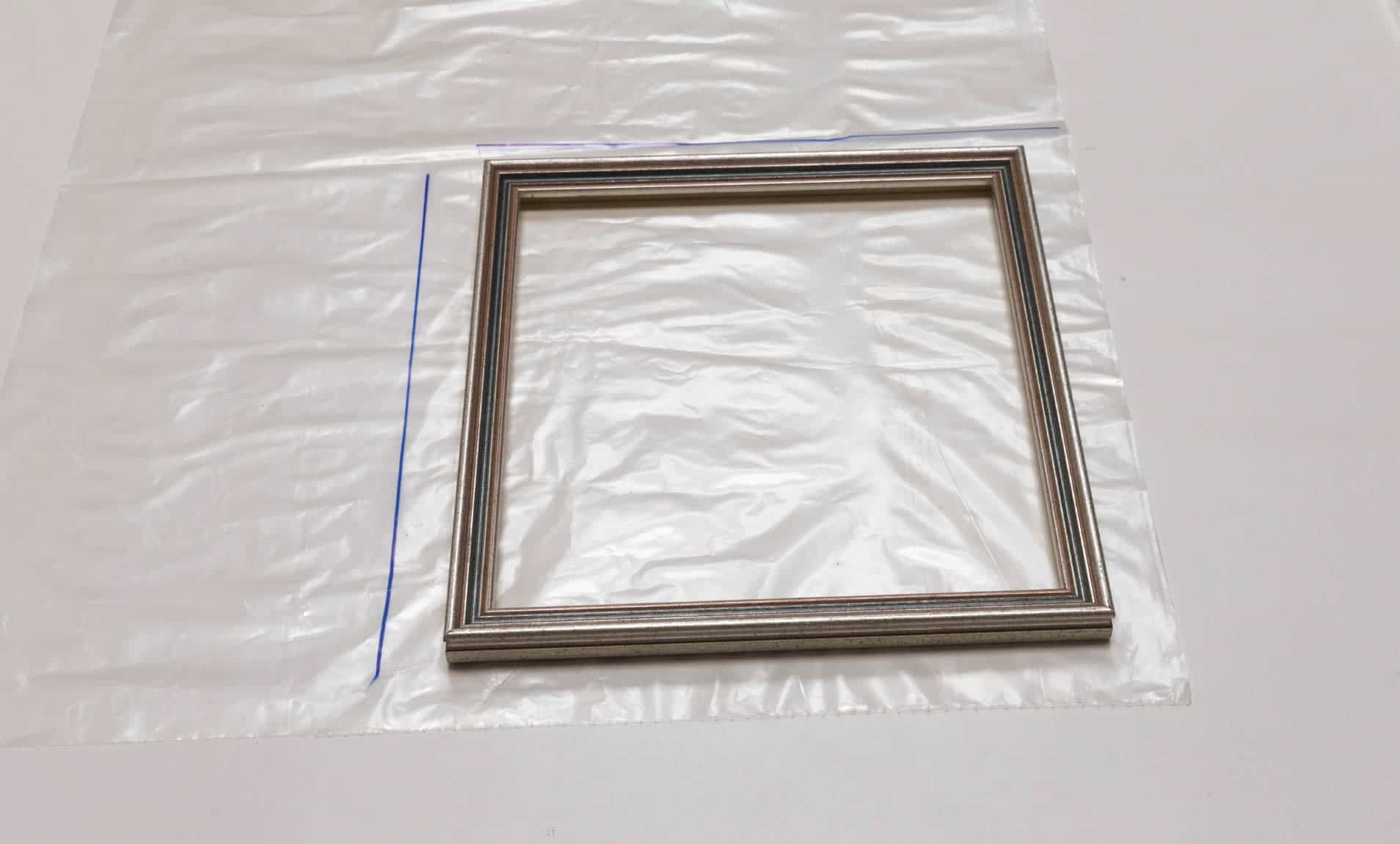step 1a - create mini indoor greenhouse - photo of picture frame on plastic