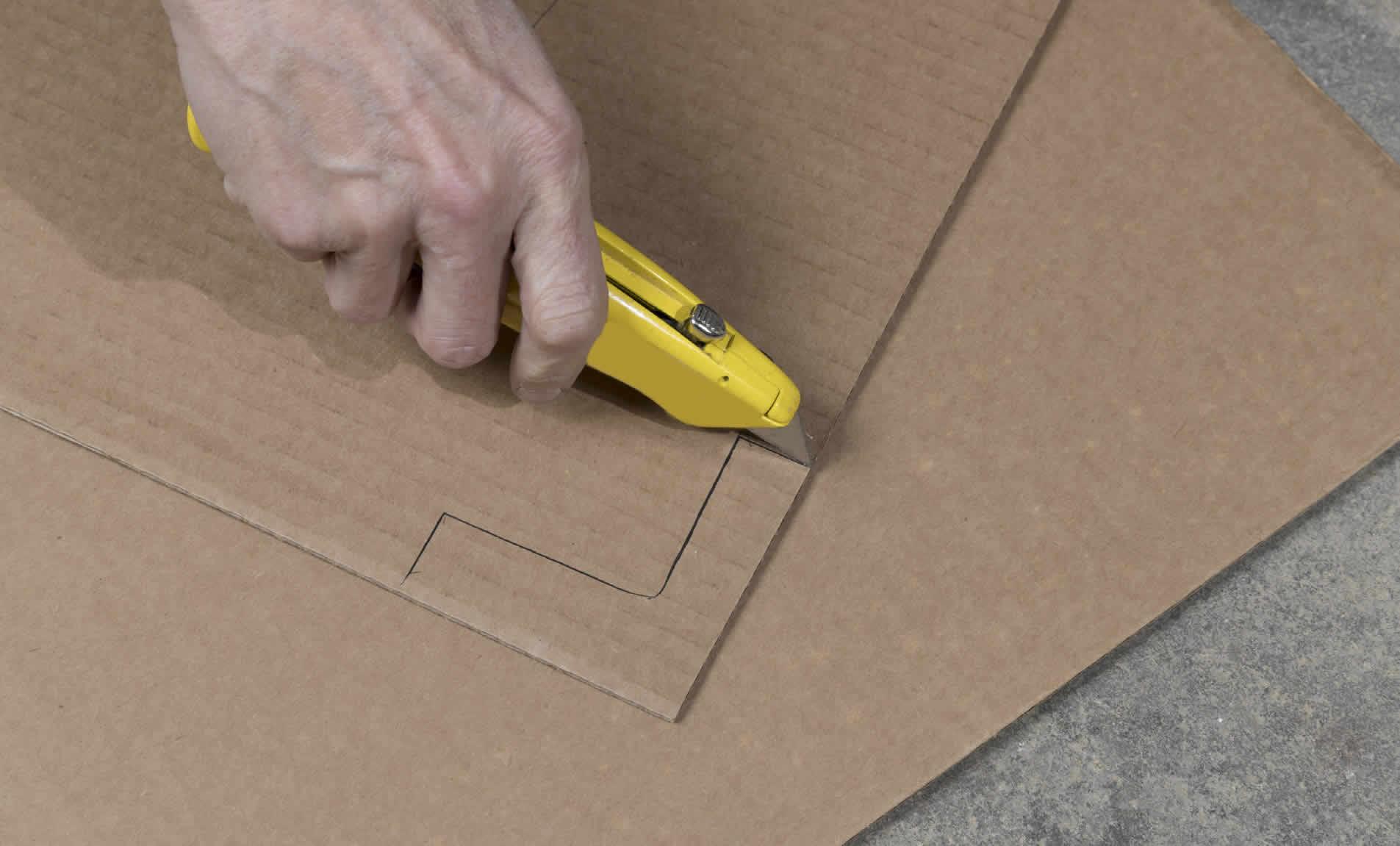 cutting cardboard with a box cutter